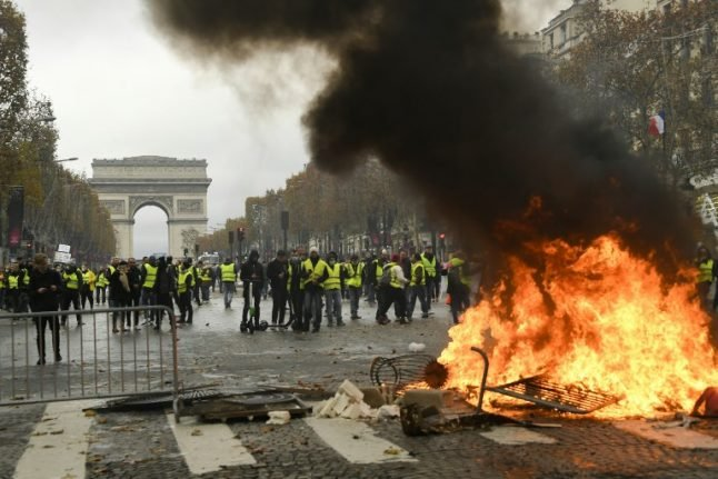 Paris: 'Yellow vest' protest marred by violent clashes with French police on Champs-Elysées