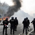 IN IMAGES: Burning barricades, tear gas and water cannon - The battle of the Champs-Elysées