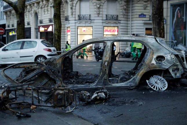 Paris in pictures: Abandoned barricades and burned cars
