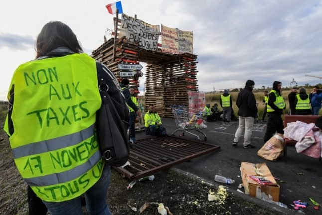 French government 'to suspend fuel tax hikes' in bid to calm violent protests