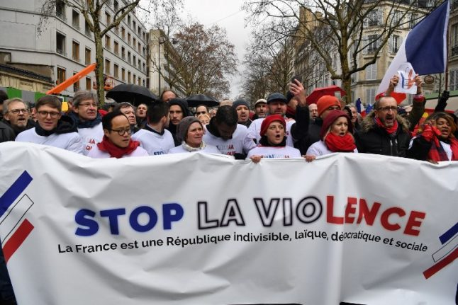 'We're the people too': 10,000 'red scarves' march in Paris against yellow vest 'revolution'