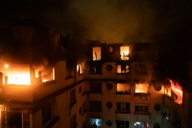 Woman charged for starting deadly Paris fire