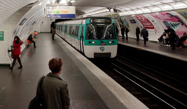 Woman pushed onto Paris Metro tracks by homeless person