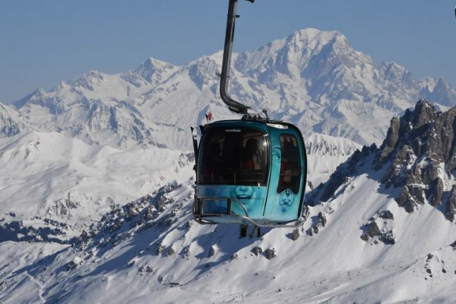 Skiers rescued by helicopter after cable car breaks down in French Alps resort