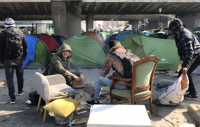 'Chaos at the gates of Paris': Inside the sprawling migrant camps nobody talks about