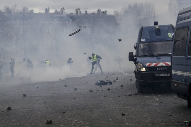 Macron battles to end controversy over use of army against 'yellow vests'
