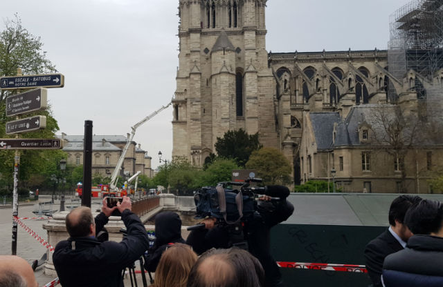'The church is burning and the whole world is crying' - Parisians mourn for Notre-Dame