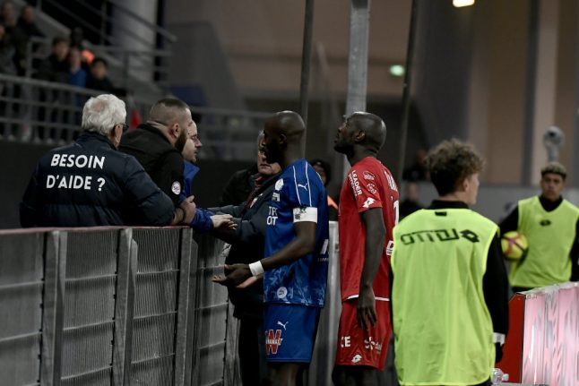 Ligue 1 match temporarily stopped due to racist abuse