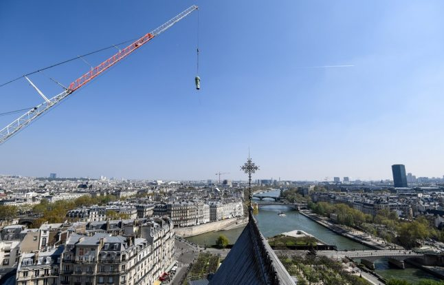 IN PICTURES: Watch Notre-Dame's 16 bronze statues being flown over Paris