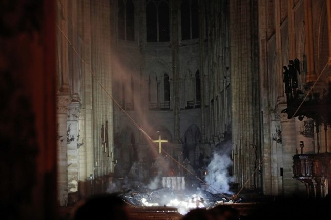 French billionaire pledges €100m to rebuild Notre-Dame as flames finally brought under control