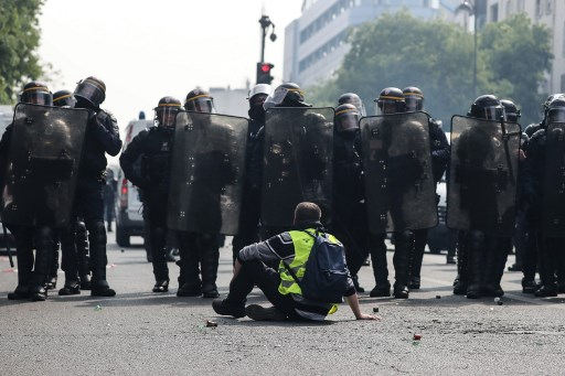 Investigation after Paris police officer apparently hurled paving stone at protesters