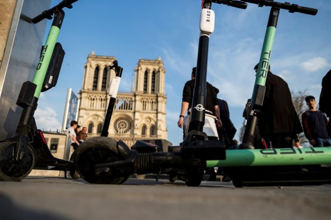 Paris threatens electric scooter firms with ban