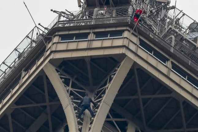 Eiffel Tower climber 'grabbed' after sparking evacuation