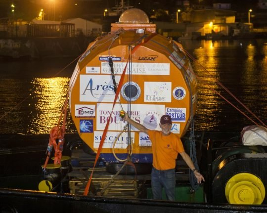 Triumphant 72-year-old Frenchman celebrates after crossing Atlantic... in a barrel