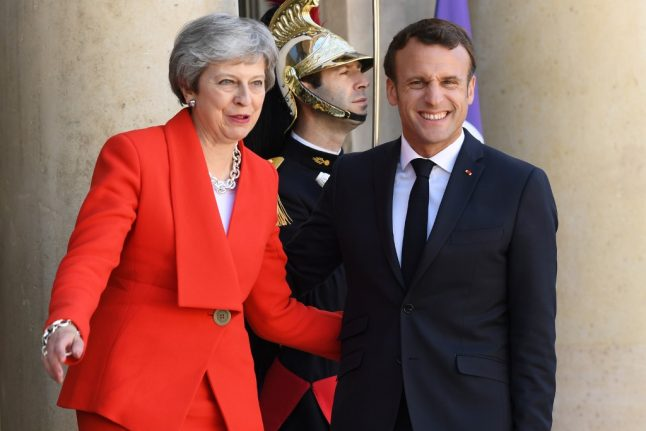 France demands 'rapid clarification' over Brexit as British PM May announces resignation