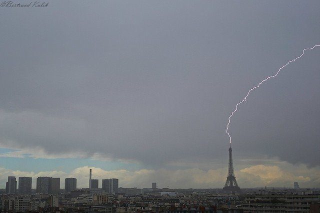 In pictures: Eiffel Tower struck by lightning as storms hit Paris