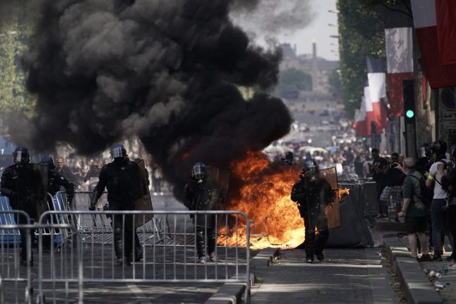 French police battle 'yellow vest' protesters then Algeria football fans in tense Bastille Day