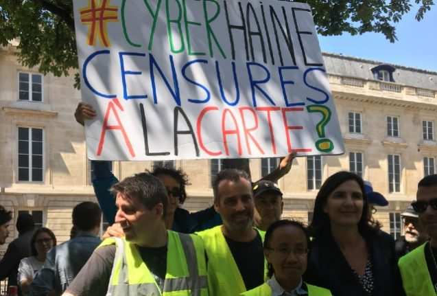 French MPs back bill forcing social media firms to remove hate speech