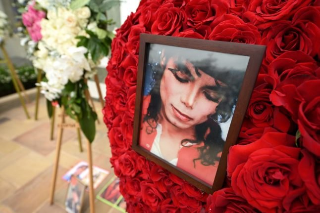 Why are Michael Jackson fans suing alleged abuse victims in France?