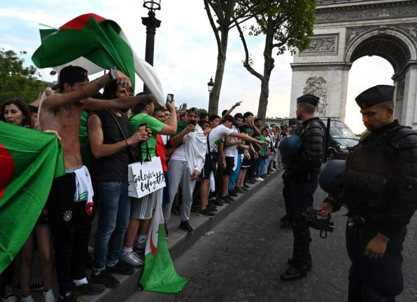 Mother killed by out-of-control car in southern France and shops looted in Paris after Algeria fans celebrate win
