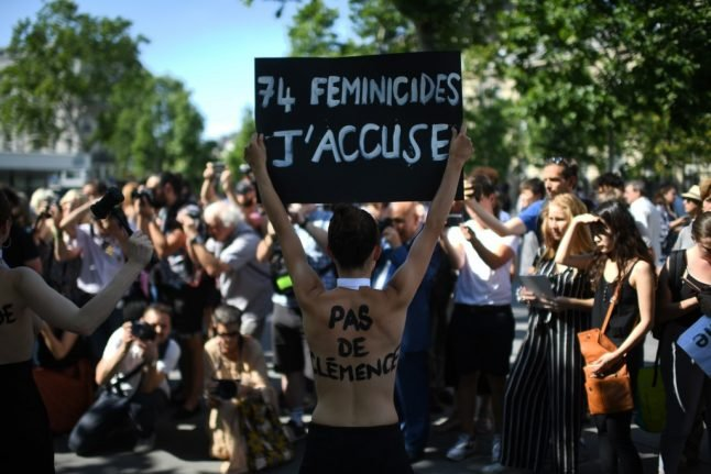 France to step up action against domestic violence as hundreds take to the streets