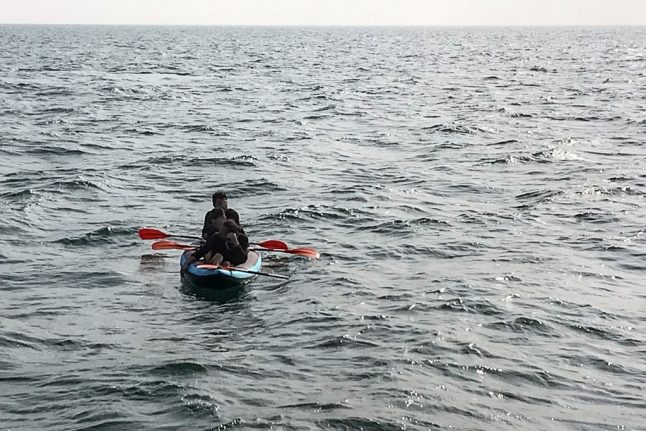 Migrant rescued swimming from France to Britain with rubber ring and flippers