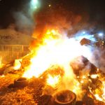 Why are French farmers lighting bonfires across the country?