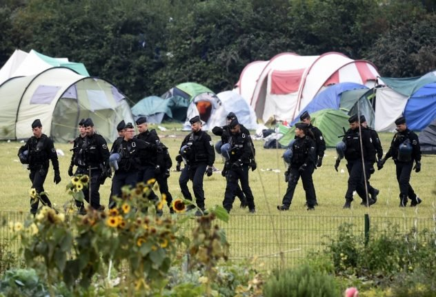 French police clear out huge migrant camp in northern Channel port