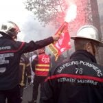 Why are French firefighters protesting in the streets?