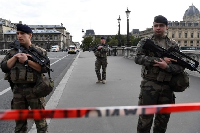 Paris police HQ killer 'stabbed three colleagues before beating a fourth to death'