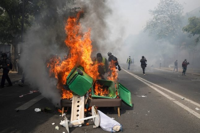 French police officer on trial for hurling paving stone at 'yellow vests' in Paris