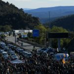 WATCH: French riot police clear Catalan protesters at highway blockade on border with Spain