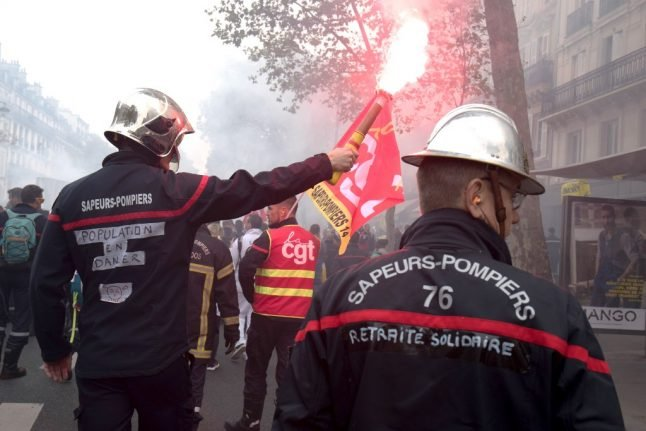 Why are French firefighters setting up camp in a Paris square?