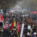 Unions in France extend strikes as 800,000 people march against pension reforms