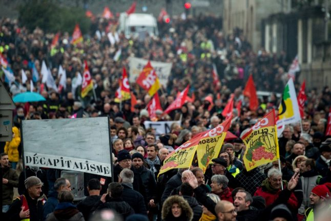 Hundreds of thousands march in France in new round of pension reform protests