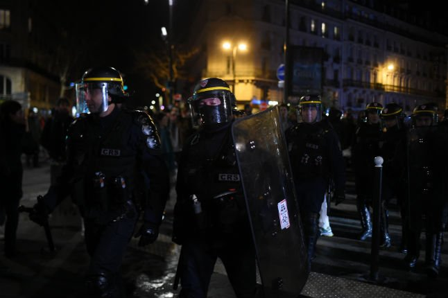 Macron rushed from Paris theatre after protesters break in