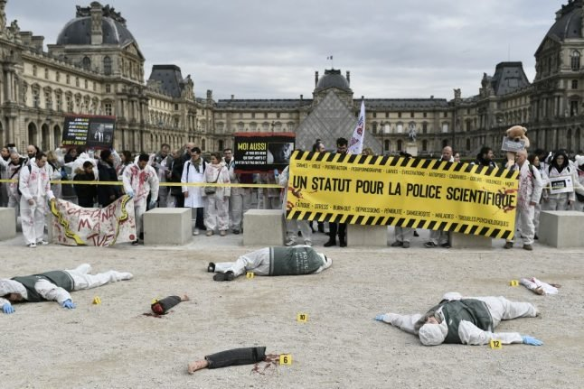 IN PICTURES: French police forensic staff stage 'severed limbs' protest