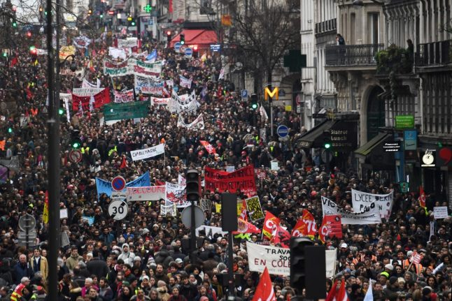 LATEST: Tens of thousands protest across France as strikes cause more transport disruption