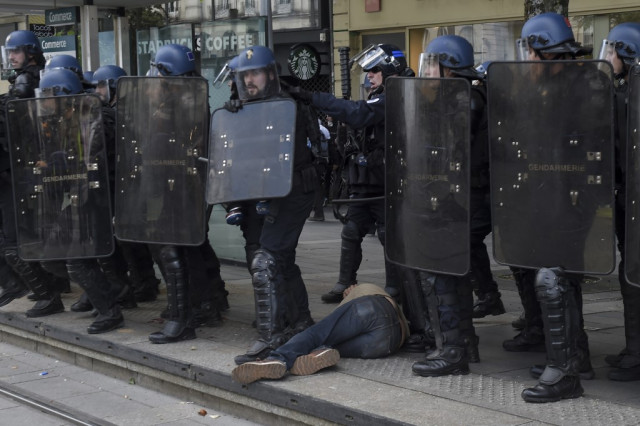 Is the punching of a Paris protester a one-off or part of a wider problem with French policing?