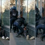 Inquiry launched into policeman who punched Paris protester