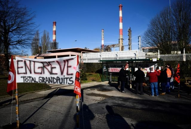 French strikers set to begin a 'total blockade' of oil refineries