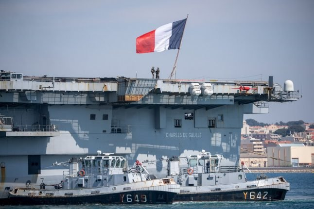 France to isolate 1,900 sailors after virus-hit naval ship docks