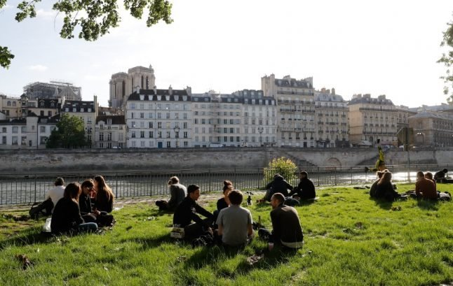 Paris police ban alcohol on canal and riverbanks after crowds gather on first day after lockdown