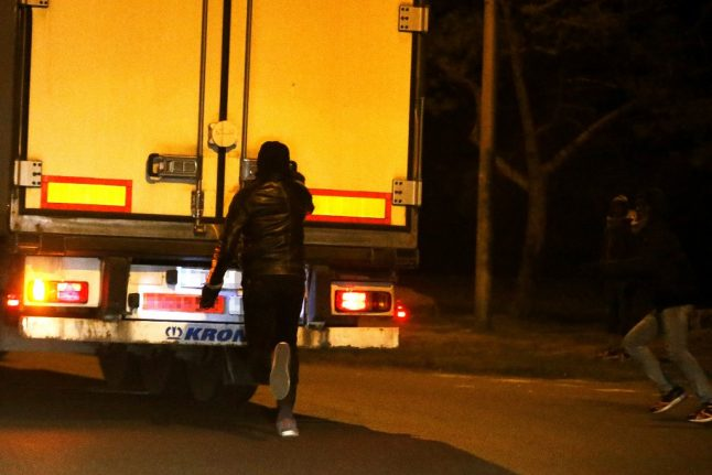 Paris police arrest 13 in migrant smuggling case linked to lorry deaths in UK