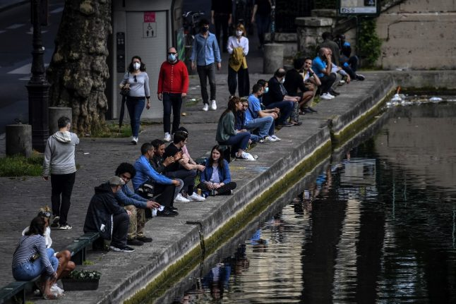 Paris police disperse crowds from trendy Canal Saint-Martin after scores gather