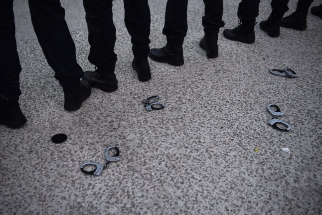Why have police in France thrown down their handcuffs?