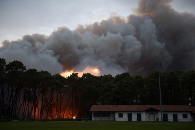Dozens evacuated as wildfire hits south west France town