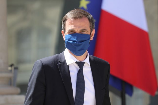 French told to 'stand firm' against virus and wear masks despite the heat