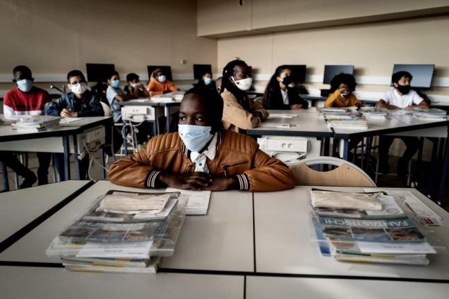 IN PICTURES: French children return to school with masks