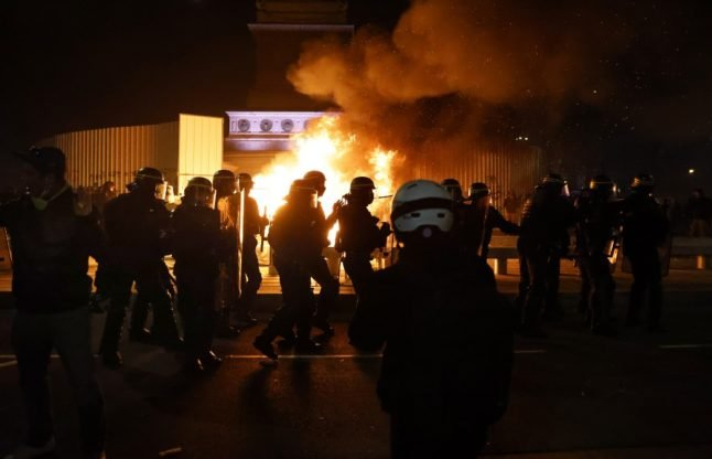 Protests in France: Interior minister condemns violence after 62 police officers injured